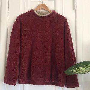 Cozy marled burgundy mock neck sweater.